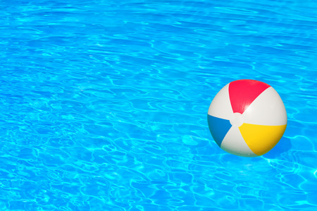 the pool: Inflatable ball floating in swimming pool