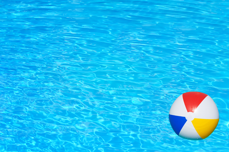 furlough: Inflatable ball floating in swimming pool