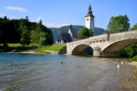 john the baptist: Church of St John the Baptist and old bridge Bohinj Lake Slovenia