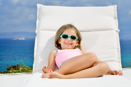 sunbed: Adorable toddler girl relaxing on sunbed Stock Photo