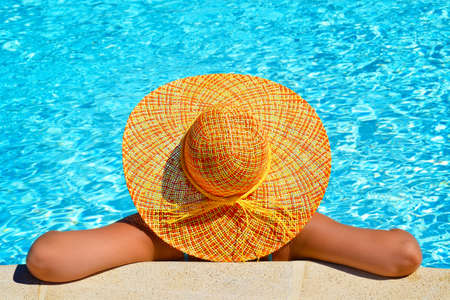 fruition: Real female beauty enjoying her summer vacation at beach and swimming pool Stock Photo