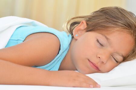 silent night: Real adorable girl sleeping, sweet dreams Stock Photo