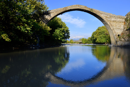 restauration: Old stone Konitsa bridge over Aoos river in Greece