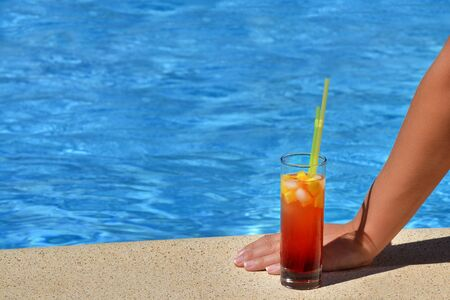 kyklades: Real female beauty enjoying her summer vacation at swimming pool drinking cocktail