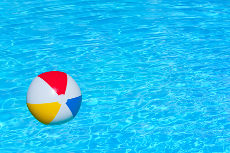 playthings: Inflatable ball floating in swimming pool