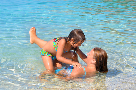 mirthful: Real adorable toddler girl enjoying her summer vacation with her mother