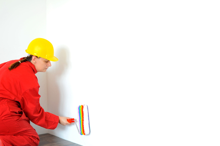 housepainter: Real female painter painting wall