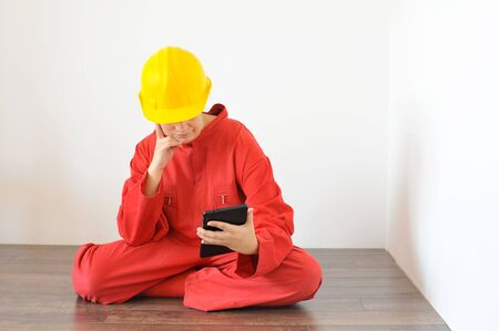 Real architect holding tablet while planing house renovation, people at work