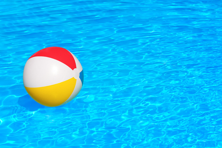 the furlough: Colorful inflatable ball floating in swimming pool Stock Photo