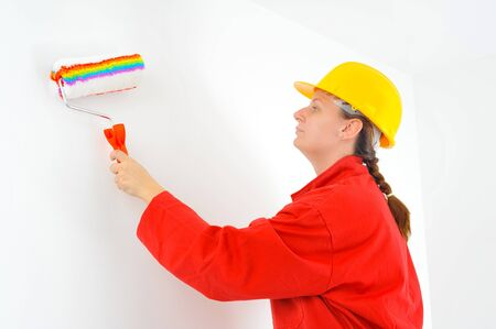 housepainter: Real female beauty painting wall Stock Photo