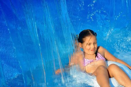 Real toddler girl at swimming pool, summer vacation concept
