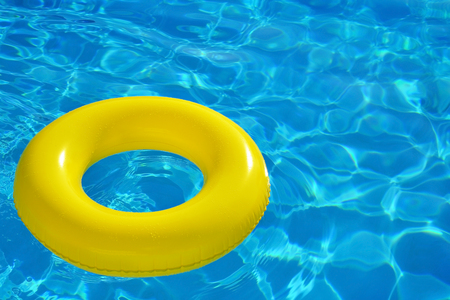 the furlough: Colorful inflatable tube floating in swimming pool, summer vacation concept