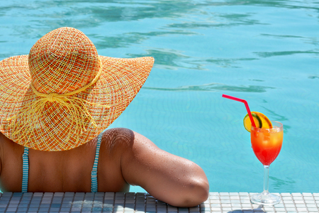 Real female beauty relaxing in swimming pool, summer vacation concept