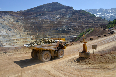 Aerial view of opencast mining quarry with heavy loaded truck Stock fotó