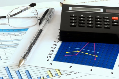Business analysis with graphical chart and calculator Stock Photo - 13116656