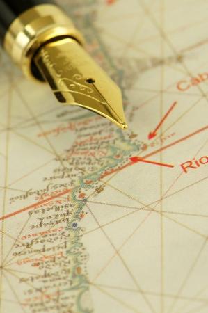 nib: A nib pen on a fragment of an ancient nautical chart representing the coast of Brazil