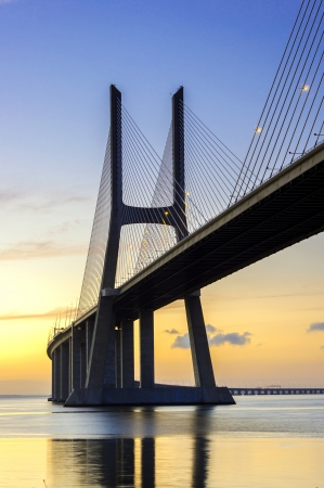 Vasco da Gama Bridge in Lisbon at sunrise photo