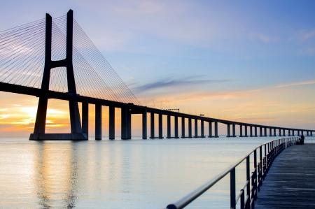 Vasco da Gama Bridge in Lisbon at sunrise photo