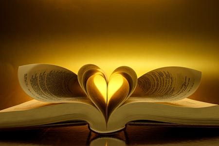 illuminated heart leaf book of the Bible Stock Photo
