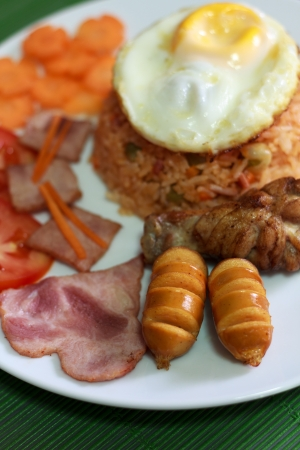 American Fried Rice on White Dish and Green Plate Mat photo