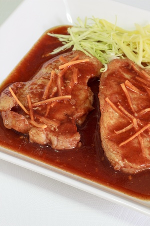 Steamed Pork with Honey Tomato Sauce on White Dish photo
