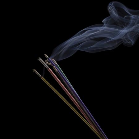 Burning Incense Sticks isolated on black