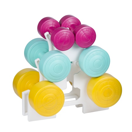 Three Pairs Of Colorful Dumbbells On Plastic Stand isolated on white