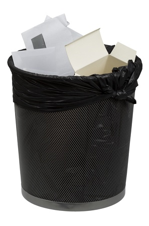 Full metal trash bin for paper with trash bag isolated on white photo