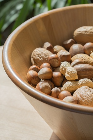 Unshelled Nuts Mix In Wooden Bowl photo