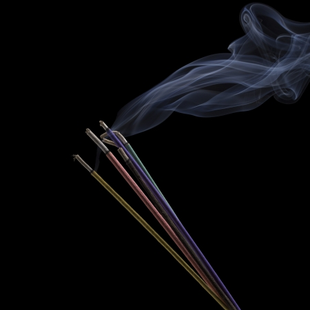 Burning Incense Sticks isolated on black photo