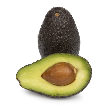 Whole Avocado and Half Avocado isolated on white photo