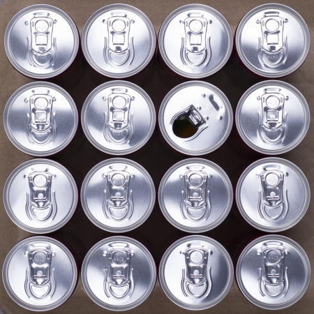 16 Drink Cans With One Opened  Top view  Stock Photo