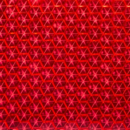 Red Retroreflector Macro Texture Photo