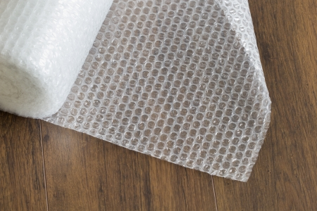 plastic wrap: wrap roll on wooden background