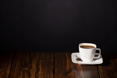 Cup of coffee  Dark scene on wooden background Stock Photo - 20870563