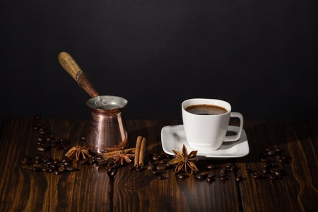 Cup of coffee and turkish pot on wooden background  Stock Photo - 20870465