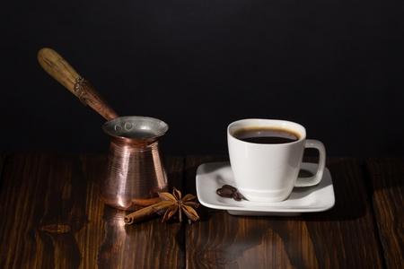 Coffee time  Dark scene on wooden background Stock Photo - 20870478