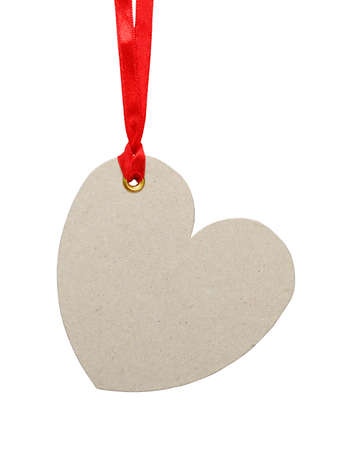 Heart shaped tag on a red ribbon  Isolated on white  photo