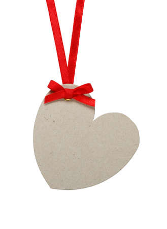 Heart shaped tag on a red ribbon with bow  Isolated on white  Stock Photo
