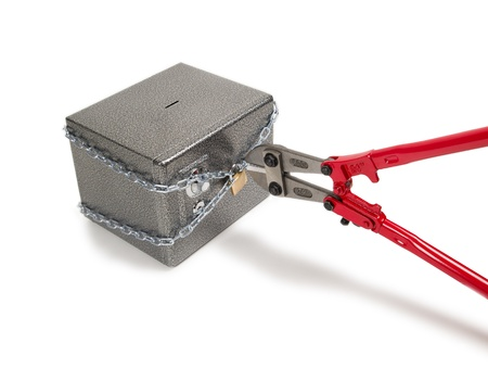 Cutting chain on safe with bolt cutters Robbery concept  photo