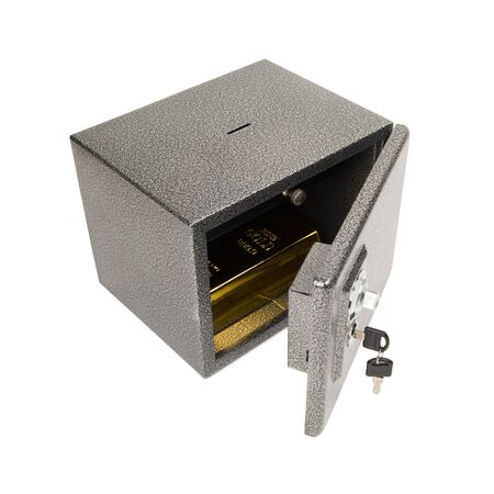 Opened safe with golden piece inside