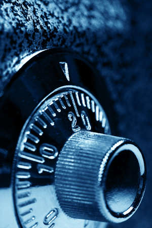 Combination lock   Dark blue colorized  Shallow DOF  Stock Photo