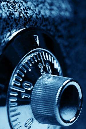 private parts: Combination lock   Dark blue colorized  Shallow DOF  Stock Photo