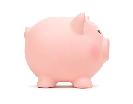Pink piggy bank isolated on white photo