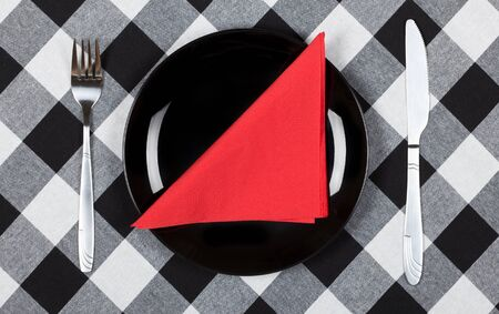 Red napkin on black plate   photo