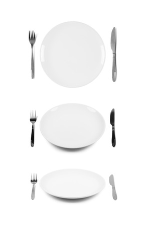 White plate with fork and knife  Isolated on white  Three angles of view  Stock Photo