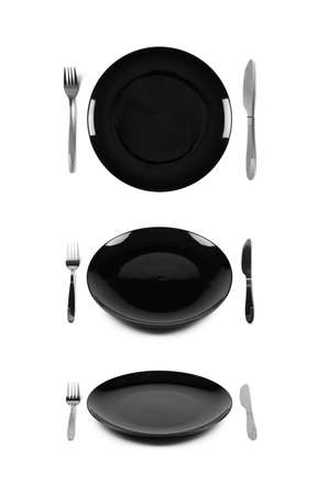 Black plate with fork and knife  Isolated on white  Three angles of view