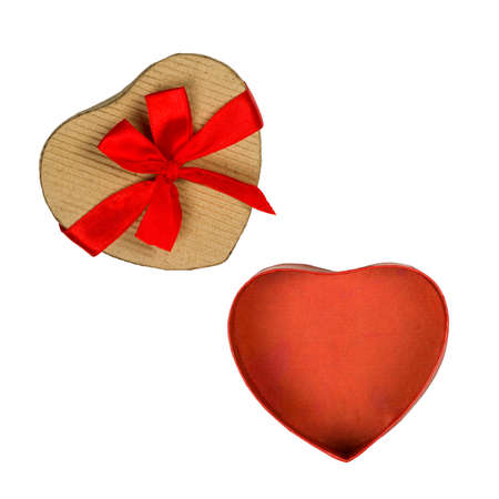 Heart shaped carton box with red bow isolated on white photo