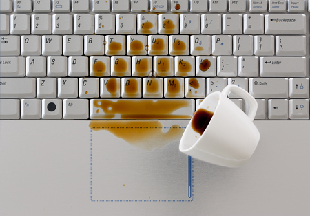 damage control: Coffee spilled on laptop keyboard Stock Photo