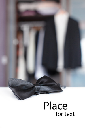 Bow tie  Open closet and tuxedo  Getting ready for formal night  With isolated place for text  Stock Photo